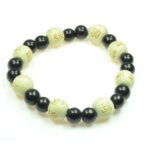 Lykkearmbånd med Onyx og træ Karma perler